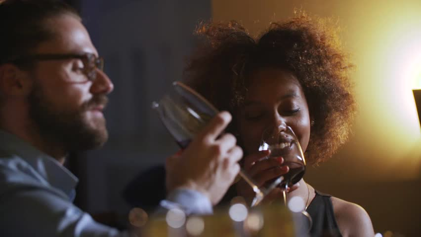 Young Couple Toasting Wine Glass In Luxury bar. Dating. Hipster and black woman on romantic dinner drinking at bar #19360684