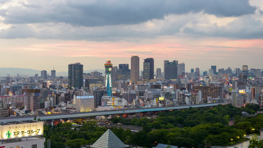 OSAKA, JAPAN - AUGUST 17, 2015: Tsutenkaku tower in the Shinsekai district. The current tower is the second to occupy the site after the first was destroyed by fire in 1943. | Shutterstock HD Video #19371160