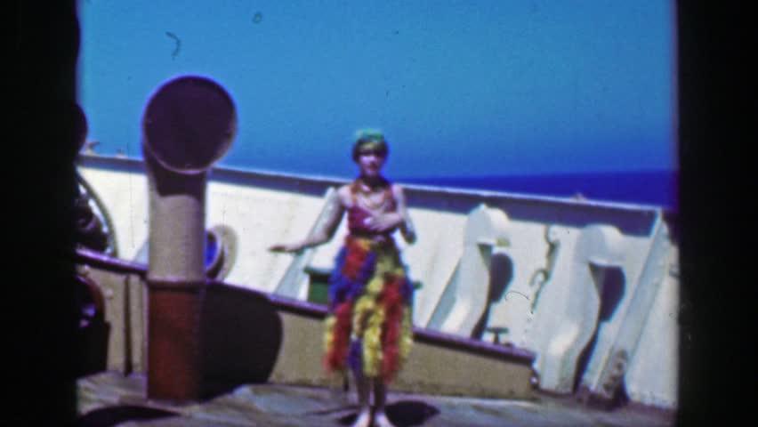 HAVANA, CUBA 1953: Gypsy girl hula performer dancing weird cruise ship deck actor entertainment.