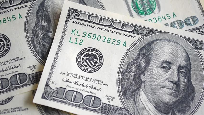 Dollar bills, money background. Dollars money set with count to bills of one hundred dollars. Portrait of George Washington closeup on the bills for a hundred dollars. Dollars, money close up.