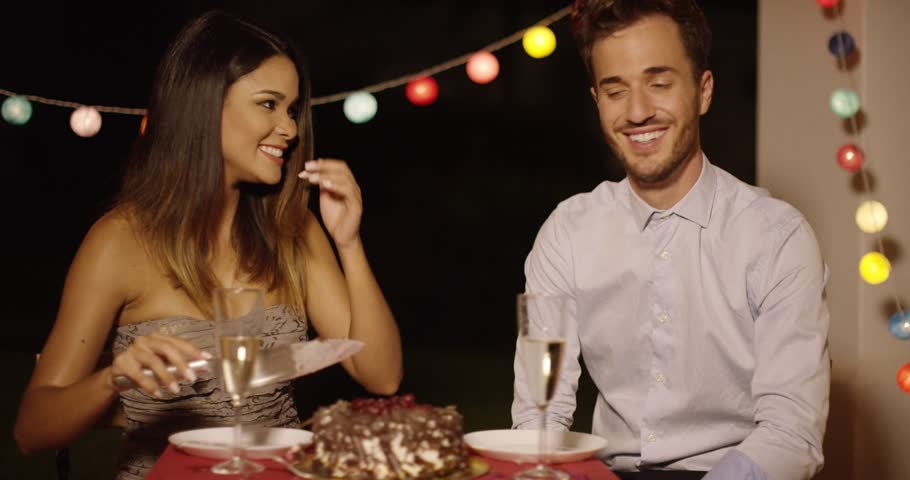 Elated young couple joking as they cut the cake | Shutterstock HD Video #19411180