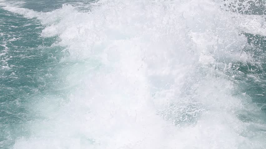 Blue ocean sea water wave with fast yacht boat wake foam of prop wash. Close up   Shutterstock HD Video #19428784
