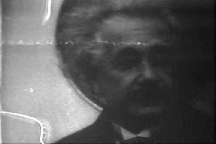 Albert Einstein is shown in a crowd in 1933. (1930s)