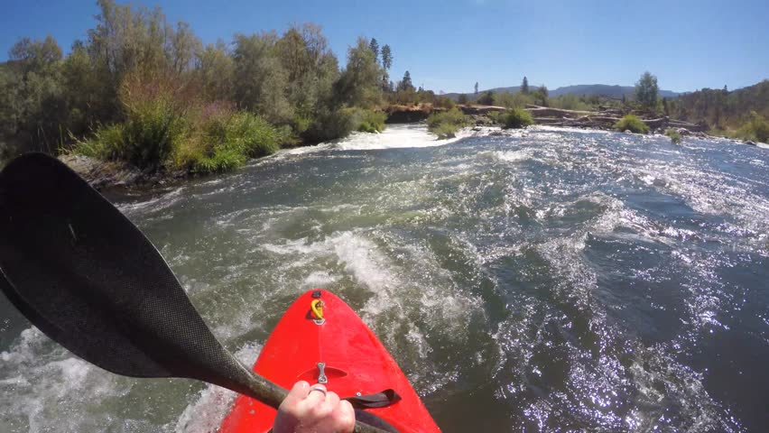 POV of kayaker running class IV powerhouse rapid on the Rogue River in Oregon.