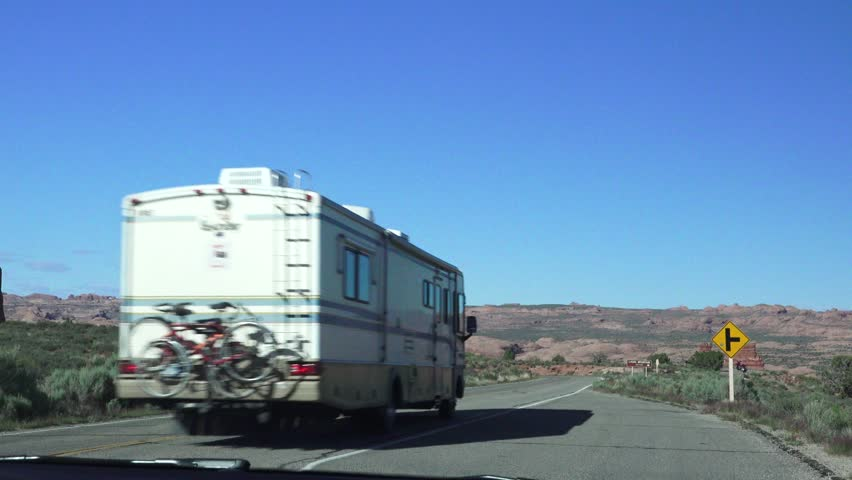 RV, motor home driving on scenic highway in Arches National Park, Destination location .