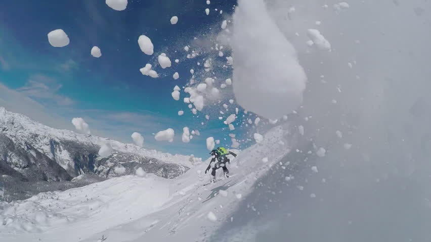 SLOW MOTION: Happy snowboarder having fun snowboarding backcountry on a sunny winter day in snowy mountains. Extreme freeride snowboarder riding fresh powder snow off piste in mountain ski resort | Shutterstock HD Video #19480054