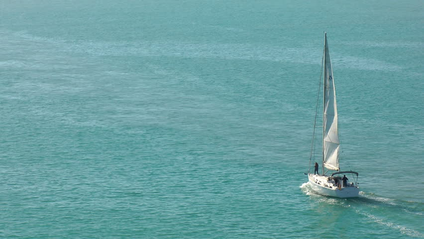 sailboat heading towards the sea