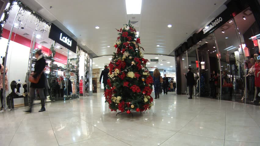 MOSCOW - DEC 21: (Time lapse View) New Year tree stands in hall in shopping center European, on Dec 21, 2011 in Moscow, Russia. People do last minute shopping for the Christmas season.