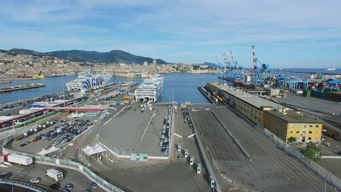 GENOA, ITALY - AUG 05, 2016: Loading of passage-boats in Passengers Port and townscape at summer day. Aerial view