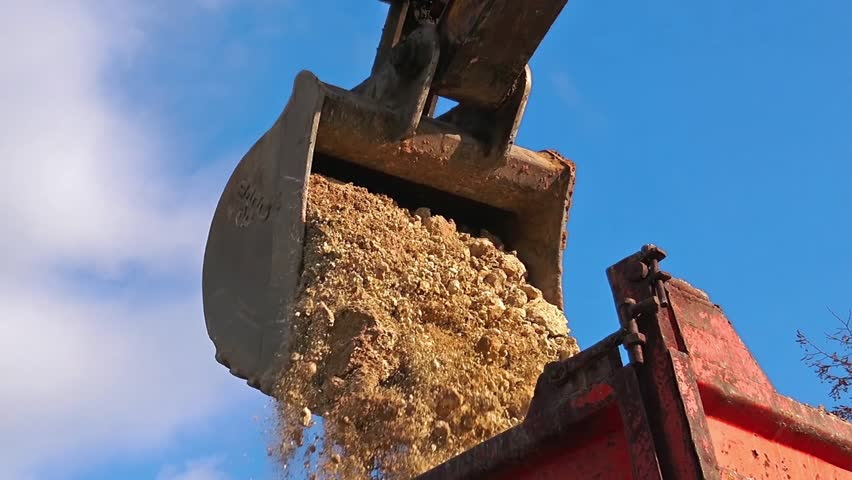 Excavator load ground in transportation truck