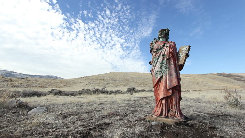 A grungy religious statue in the middle of nowhere. | Shutterstock HD Video #1955512