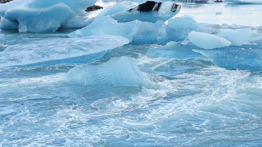 Glacier on black volcanic beach, Iceland. | Shutterstock HD Video #19563370