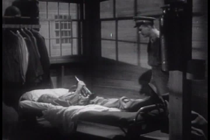 A US Army bugler is woken up so he can go wake up the camp in 1950. (1950s) | Shutterstock HD Video #19627276