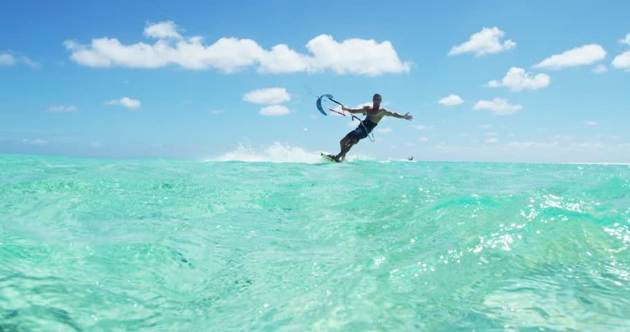 Young man kitesurfing in tropical blue ocean #19646824
