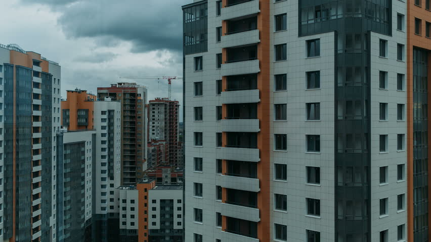 Multi-storey residential buildings, sleeping area. movement of clouds on a background of urban buildings. day time lapse video in cloudy weather. camera movement from the bottom up | Shutterstock HD Video #19660399