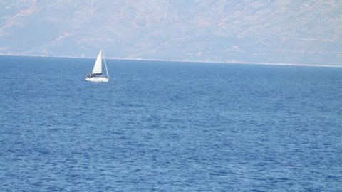 Footage of a small boat sailing on a sea...