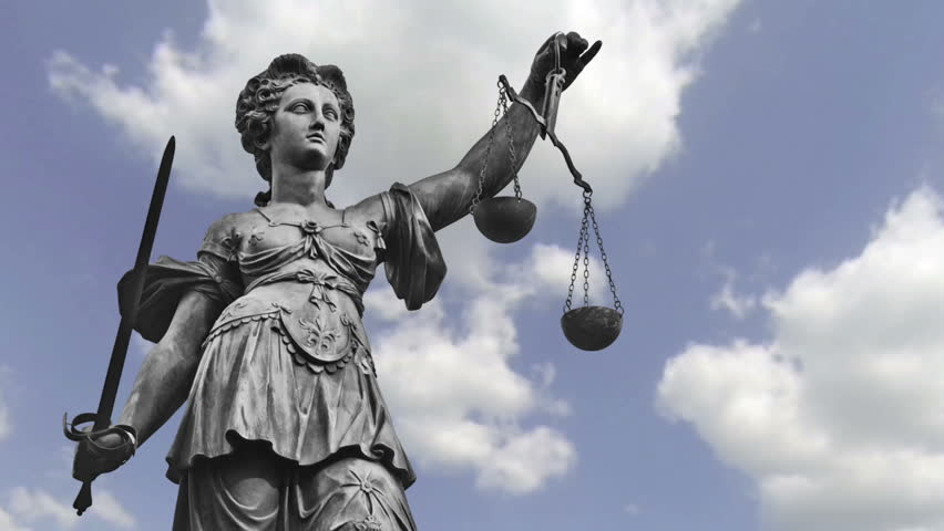 Statue of Lady Justice zooming out in front of moving clouds, Full HD | Shutterstock HD Video #19725403