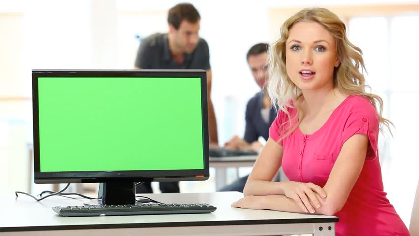 Woman presenting product on desktop computer screen