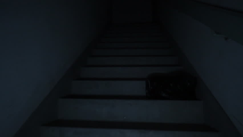 Climbing spooky stairs in darkness. Going up dark and dangerous stairs in creepy stairwell alone. Smooth movement floating up fire stairs with no light.