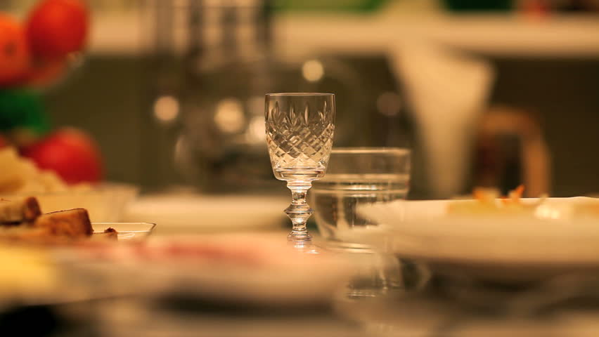 glass of alcohol on the table, drinks and snacks,   close-up
