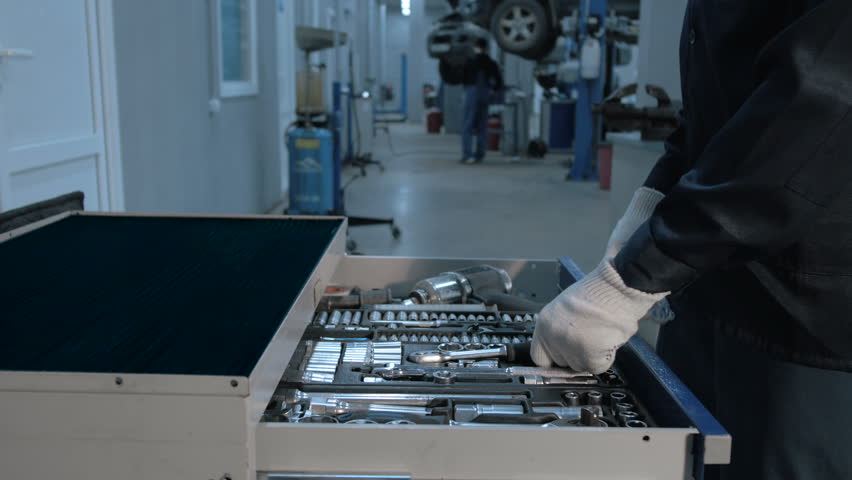 Mechanic open Blue Metal Box with Different Tools for Car Repair at Modern Service station   Shutterstock HD Video #19769134