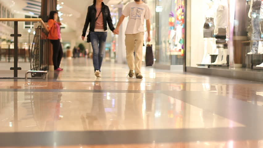 young couple in a shopping mall, slow motion