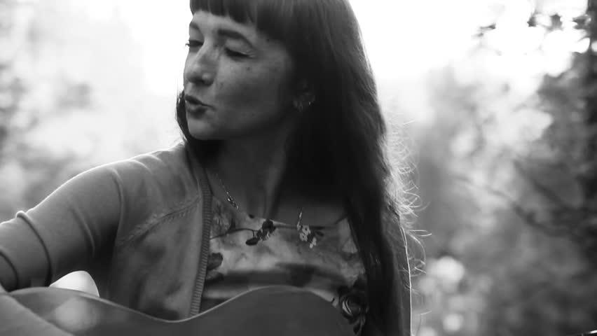 Beautiful girl playing the guitar. Monochrome | Shutterstock HD Video #19787917