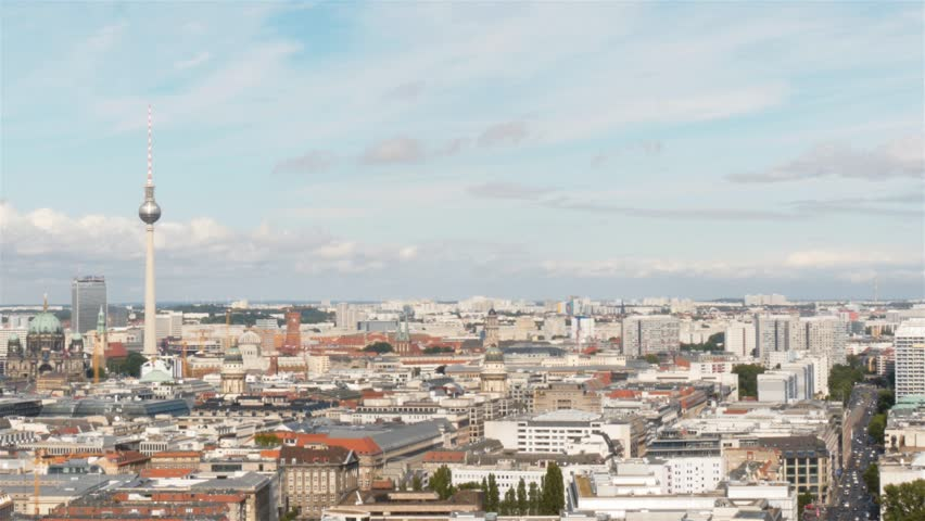 Pan, left to right, panoramic shot of Berlin from Potsdamer Platz skyscrapers toward east Berlin. Berlin TV tower and hot air balloon in Berlin.