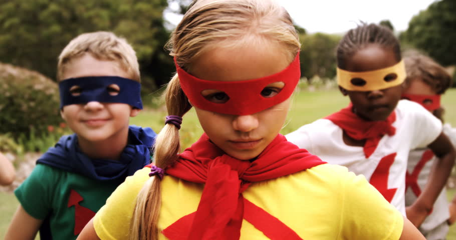 Portrait of group of Caucasians and African-American  kids pretending to be a super hero in the park 4k