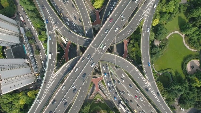 Overhead aerial drone view of the enormous Yan'an elevated freeway intersection, one of the busiest converging road junctions in Shanghai, urban China. | Shutterstock HD Video #19836094