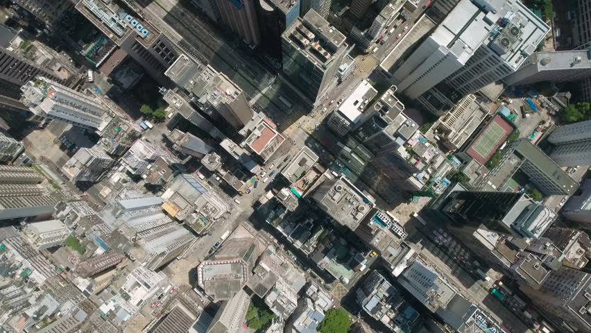 Aerial drone shot flying over residential apartment buildings and commercial property in urban Kowloon in Hong Kong.   Shutterstock HD Video #19843186