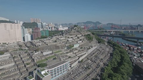Flying over a large graveyard located on a steep hill in Hong Kong.
