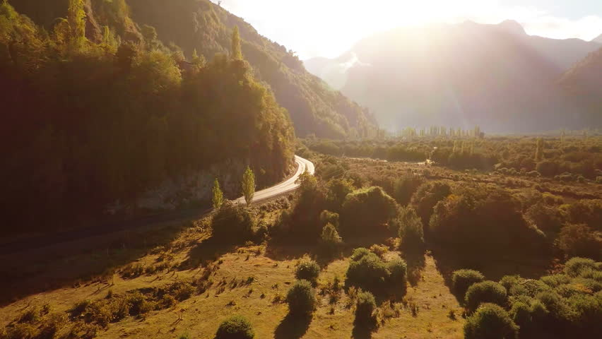 Aerial: Sunrise tracking shot in beautiful mountain valley Patagonia 2K