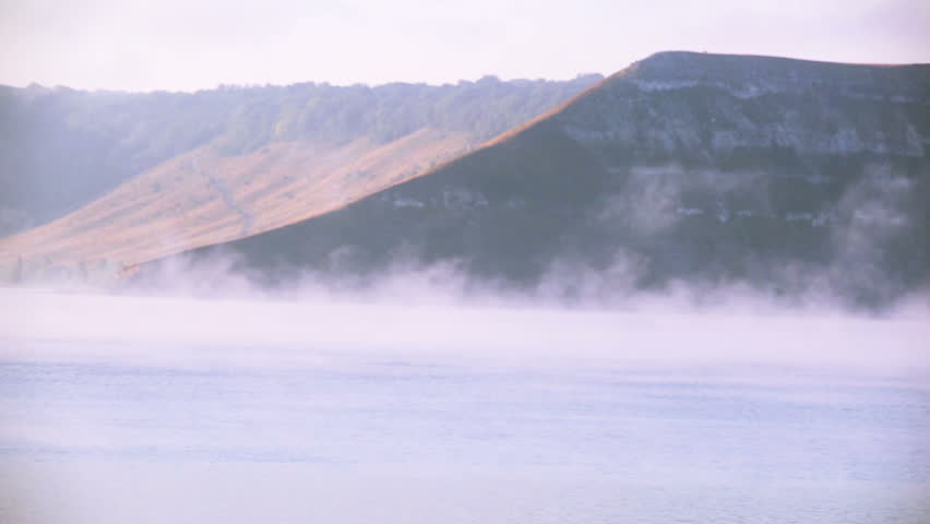 Morning fog over   lake and hills  .  | Shutterstock HD Video #19877176