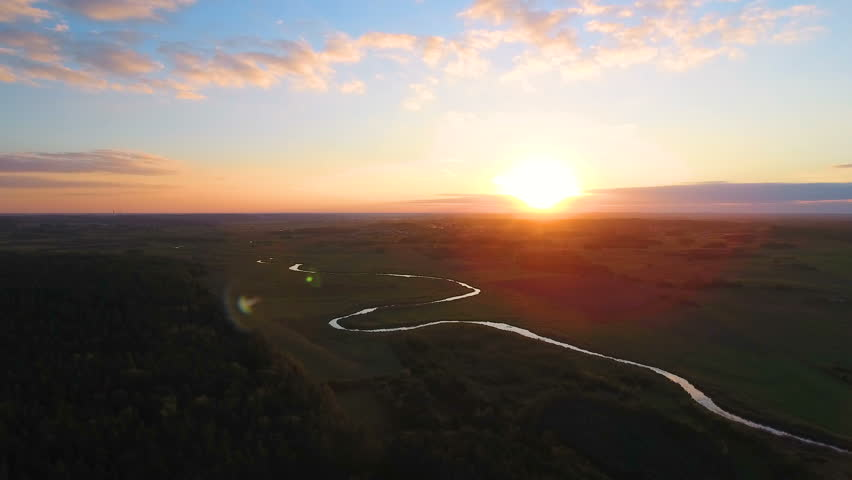 Flight above the picturesque green landscape,river, ground, grass. During sunset.  Aerial View. | Shutterstock HD Video #19884526