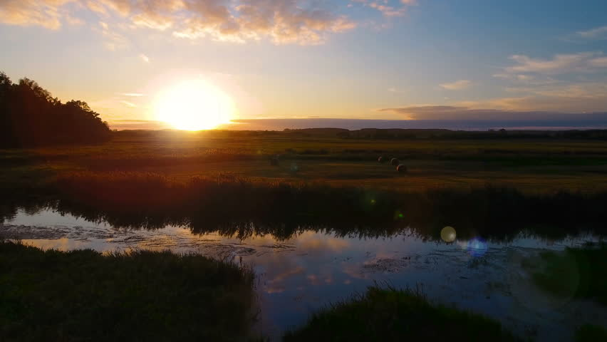 Flight above the picturesque green landscape,river, ground, grass. During sunset.  Aerial View. | Shutterstock HD Video #19884544