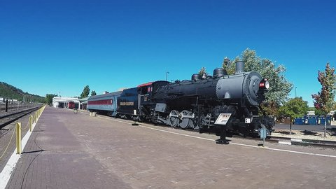WILLIAMS, ARIZONA/USA: August 10, 2015- A wide shot of one of the historic locomotive trains that make up part of the Grand Canyon Railway passenger service to the Grand Canyon.