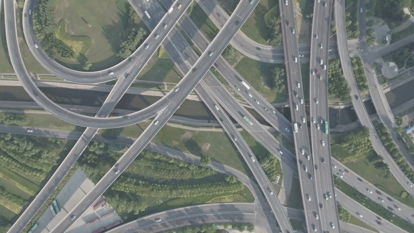 Panoramic aerial footage of a huge network of flyovers, junctions, intersections, roads, bridges etc in Zhengzhou, urban China.  | Shutterstock HD Video #19909600