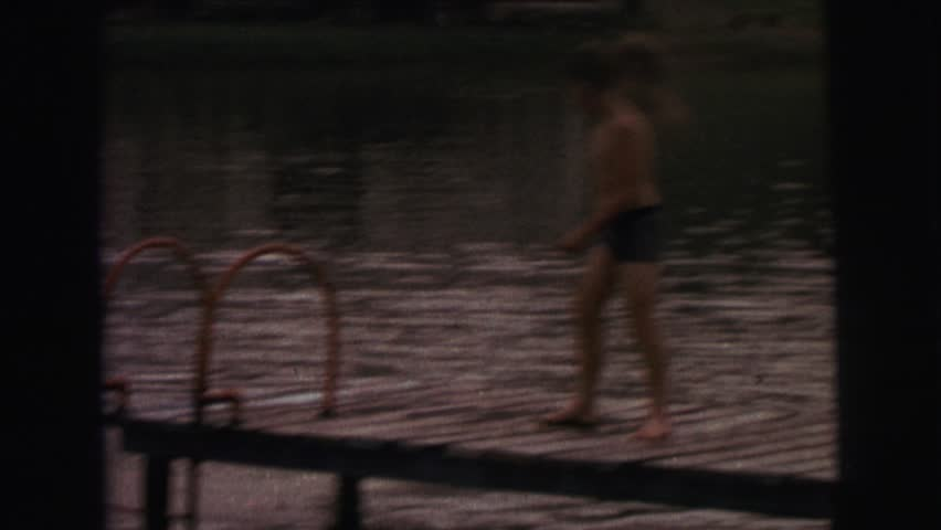LYNBROOK, NEW YORK 1974: a child is seen dipping in a pool | Shutterstock HD Video #19957591