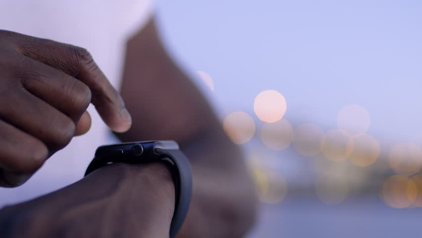 Closeup Of Man using His Smartwatch With City Lights In Background | Shutterstock HD Video #19969642