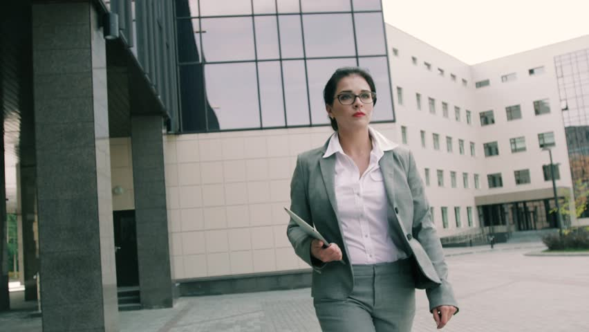 Young business woman walking to the office building #19975834