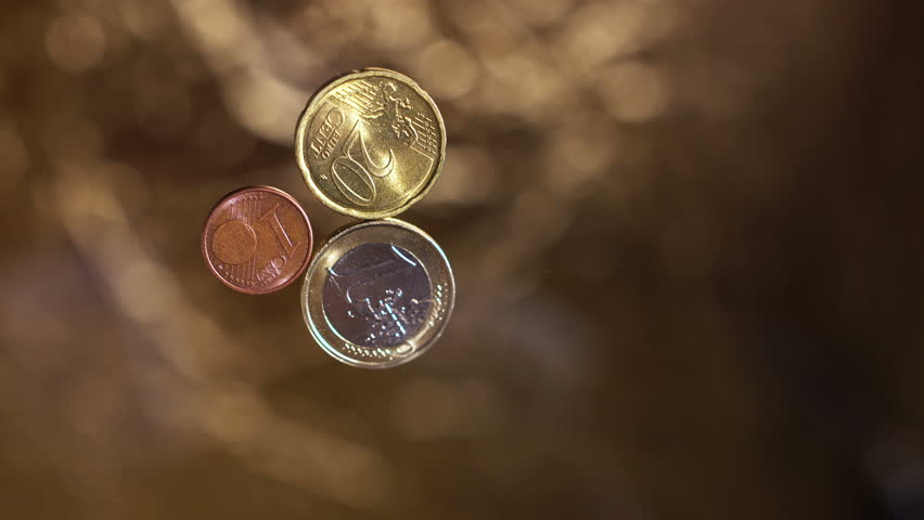 Euro cents on a blured golden background 4K | Shutterstock HD Video #19987396