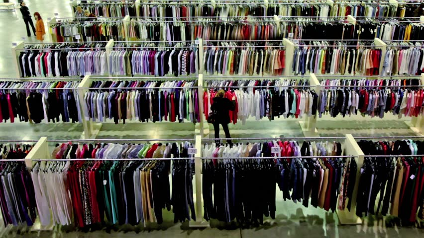 Several women watch goods among lot of clothes in large shop | Shutterstock HD Video #1999433