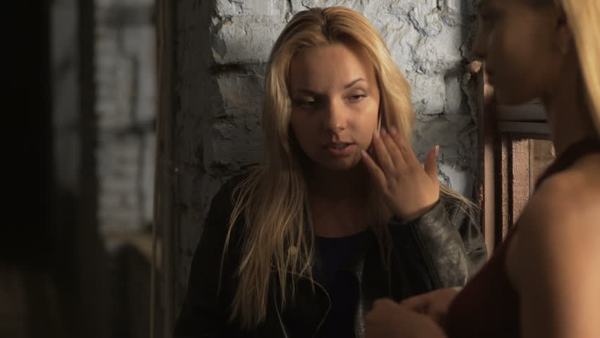 Two drunk blondes lighting up cigarettes, smoking near nightclub, bad habits | Shutterstock HD Video #20040337