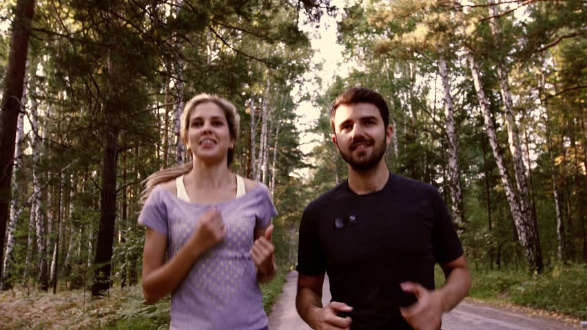 Portrait of a couple running joyfully in nature | Shutterstock HD Video #20044501