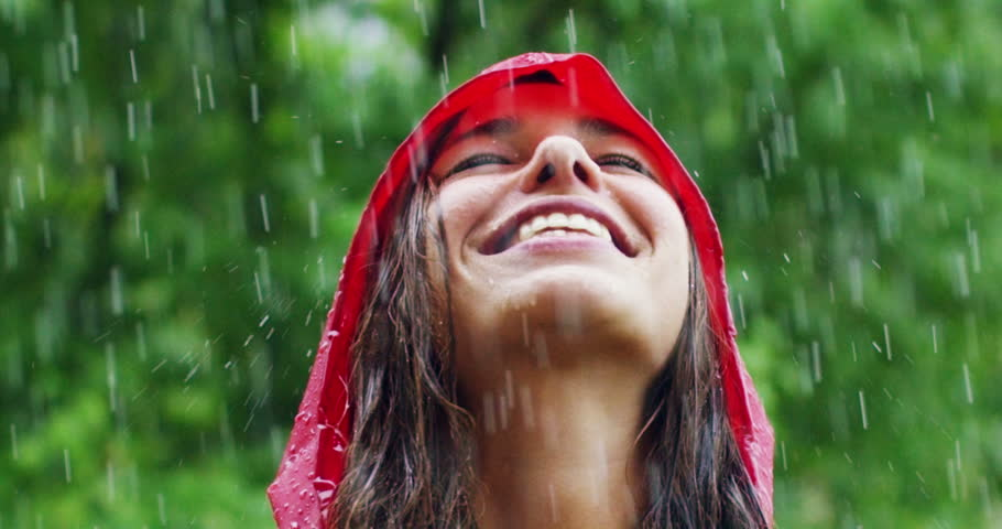 A happy woman smiles in the rain, the woman immersed in the nature of dance under the happy and free rain in slow motion. Concept of love, nature, happiness, freedom. | Shutterstock HD Video #20072284