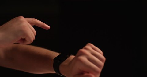 Man Tapping Smart watch slow motion - isolated on black background