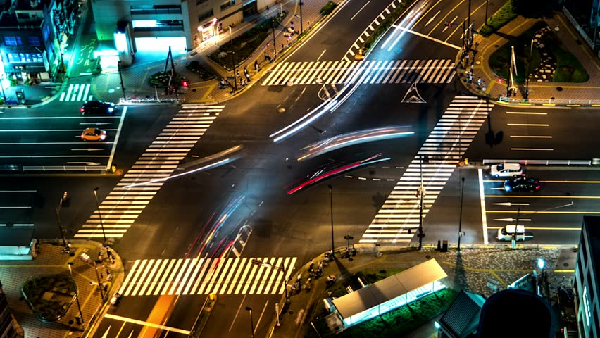 Tokyo - Aerial view of junction with glowing light trails from traffic . 4K resolution time lapse zoom out. June 2016 #20083939