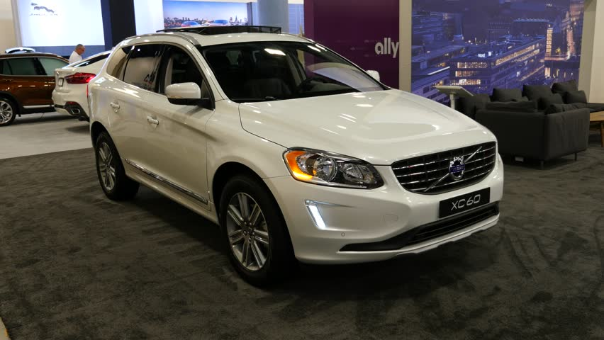 MIAMI, USA - SEPTEMBER 10, 2016: Volvo XC60 T5 FWD SUV on display during the Miami International Auto Show at the Miami Beach Convention Center. #20084197
