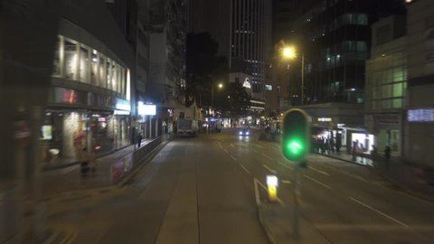 HONG KONG, CHINA - FEBRUARY 08, 2016: The night streets of Hong Kong, view from the window of a moving double-decker bus, timelapse 4k